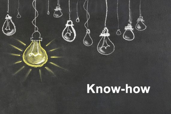 The chalkboard drawing shows multiple light bulbs in a row with one glowing. The light bulbs are hanging from the top. The small light bulbs are outlined in white,the big light bulb is yellow. The big light bulb is a symbol of innovation e/o success.